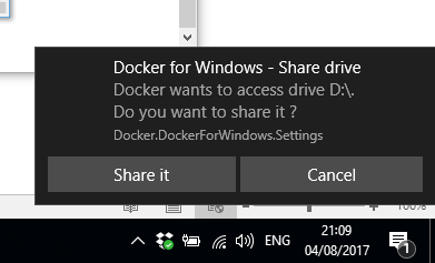 "Image of the Docker for Windows - Share drive popup message with the text ""Dockeer wants to access drive D:\. Do you want to share it? Docker.DockerForWindows.Settings"". It has two buttons: Share it and Cancel."