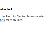 "Screenshot of the Docker for Windows error popup window with the message ""Firewall detected - A firewall is blocking file Sharing between Windows and the containers. See documentation (a link) for more info."