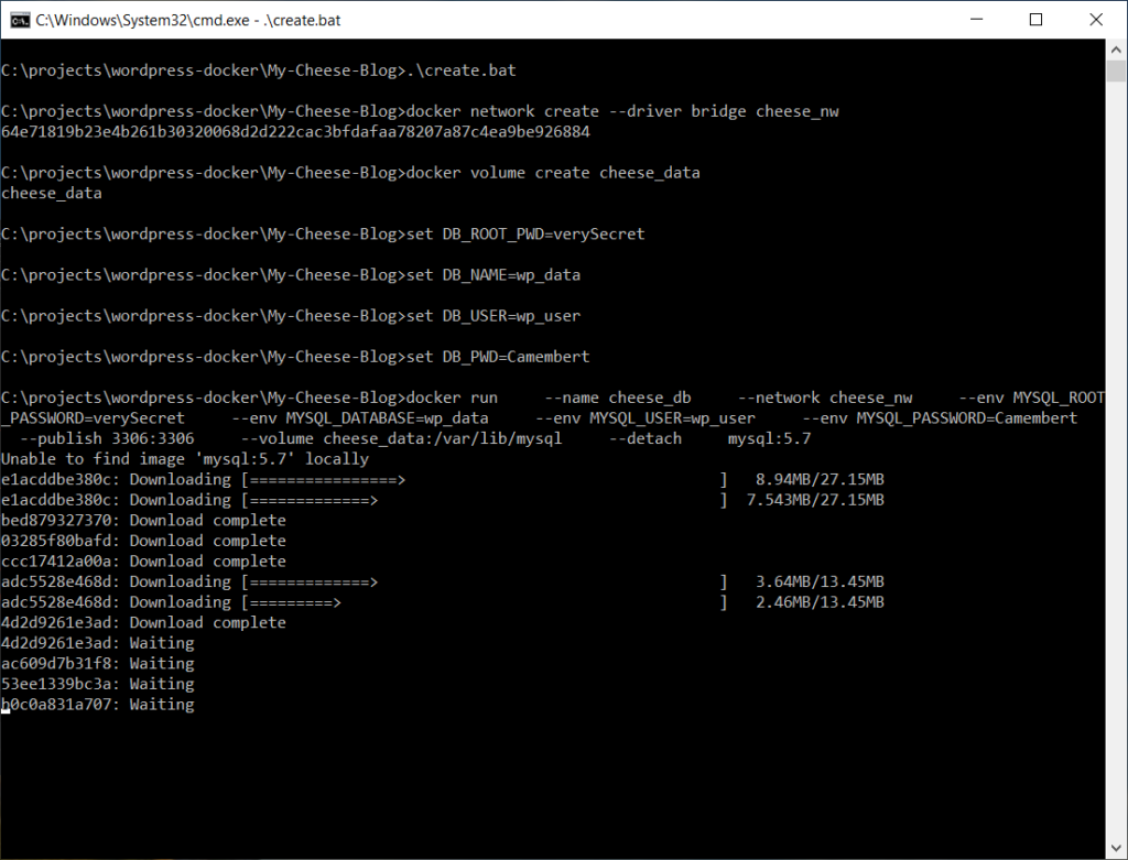 A screen shot of a Windows command shell while running create.bat showing Docker downloading MySQL image layers.